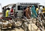 Urban Transport in Chad: Motorcycle taxi drivers await customers