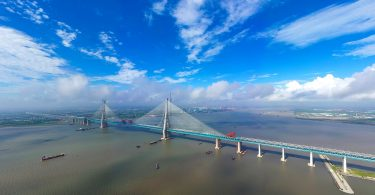The world's longest cable-stayed bridge, the Hutong (Shanghai-Nantong) Yangtze River Bridge, is under construction on the Yangtze River in Nantong