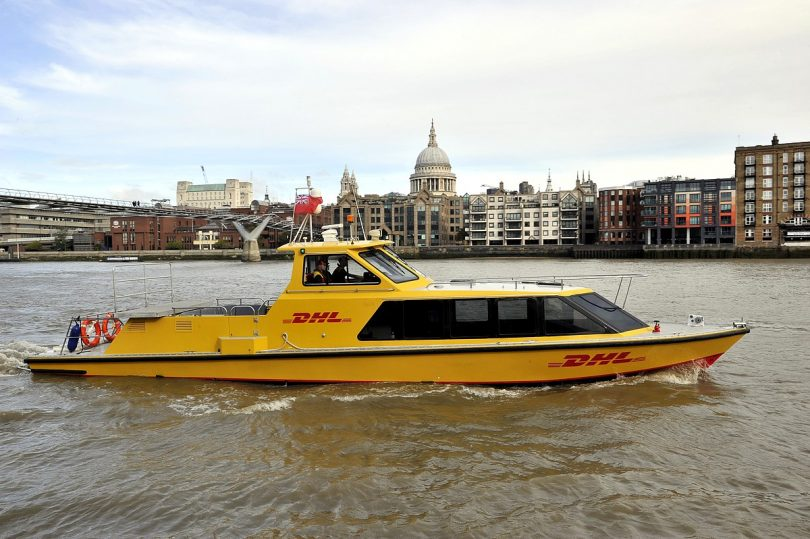 dhl-express-riverboat-on-river-with-st-pauls