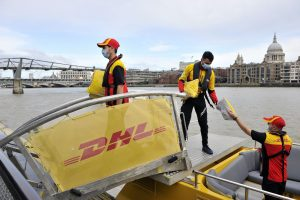 Daily DHL Express riverboat freight service to transport small packages into central London for last mile delivery by bike.